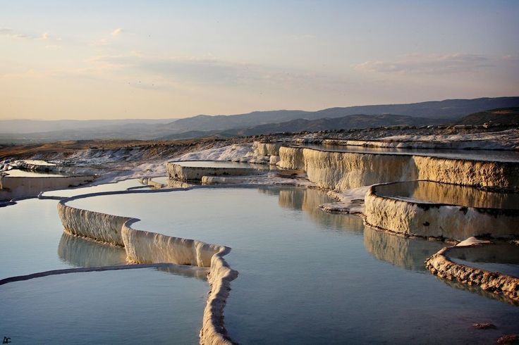 """Pamukkale, Turkey, meaning """"cotton castle"""" in Turkish. Pamukkale is a natural site in southwestern Turkey. The city contains hot springs and travertines, terraces of carbonate minerals left by the flowing water. Photo by Andrea Catelli -- National Geographic Your Shot"""