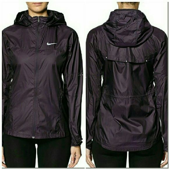 Nike Purple Running Lightweight Rain Jacket XS New with tags. Perfect condition. No trades. Deep purple rain jacket perfect for running on rainy days, or just to be worn on any rainy day. Zipper pockets. Removable hood. Lightweight and packable. 100% polyester. Nike Jackets & Coats