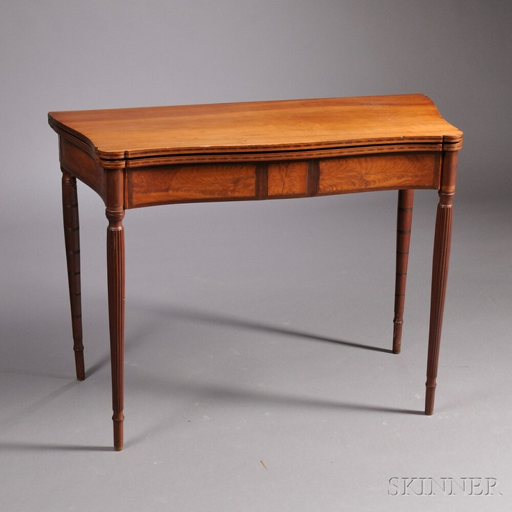 Lot 289   Federal Carved Cherry and Flame Birch and Mahogany Veneer Card Table, New England, c. 1810-15, the serpentine top with ovolo corners and half-serpentine ends, on turned and reeded legs joining a conformingly shaped skirt inlaid with flame birch panels, stringing, and mahogany banding, refinished, (minor imperfections), ht. 29 1/2, wd. 38, dp. 17 1/2 in.   Estimate $1,000-1,500