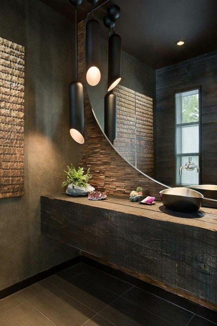 salle de bain en marron foncé, miroir design rond, sol en dalles marron foncé