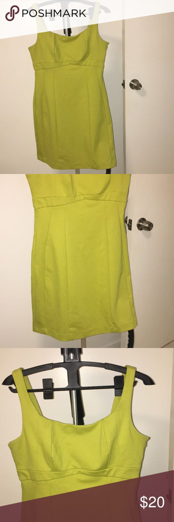 Lime Green Structured Shift Dress Gorgeous structured lime green dress. Flattering neckline and squared off back. Really compliments curves nicely as it has symmetrical lines around the bottom!! Very nice thick material. Worn just three times. Can be worn as is or with a cardigan or blazer. Great for work or going out. New York & Company Dresses