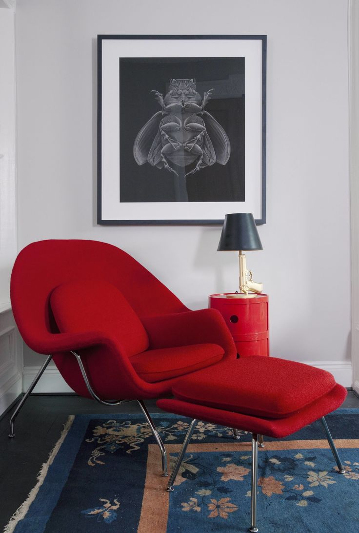 Womb chair living room - The Bright Red Womb Chair And The Matching Kartell Side Table Brighten Up A Dark Corner