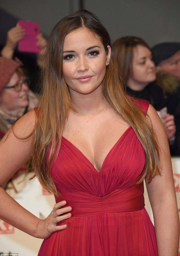 Natural beauty: Jacqueline was glowing in her red gown which gave a hint of her perky clea...