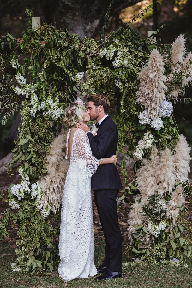 Grace Loves Lace real bride and incredible pampas grass backdrop