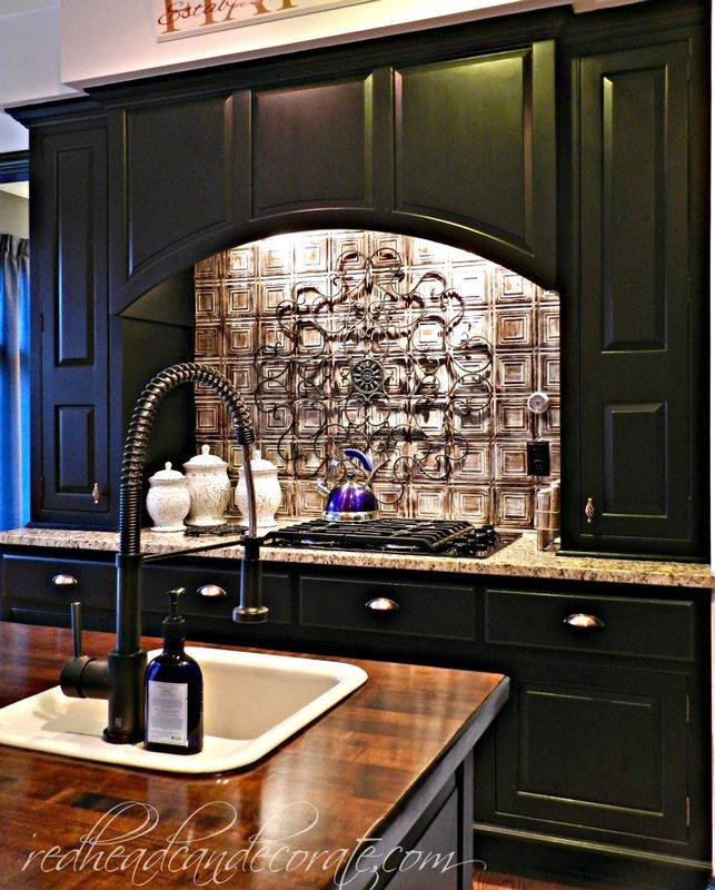 Husband & wife transform their wood cabinets with black paint, and he stripped the island down to the original wood and stained it mahogany.  #DIYkitchenmakeover #affordabledecorideas