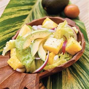 Avocado and Pineapple Salad ~ 8 cups iceberg or other crisp lettuce   2 cups fresh pineapple chunks   1 medium red onion, thinly sliced   1/3 cup extra-virgin olive oil   1/3 cup white vinegar  1/3 cup fresh orange juice   1/4 cup sugar   3/4 teaspoon salt   1/2 teaspoon pepper   2 medium avocados, sliced   Fresh lime wedges
