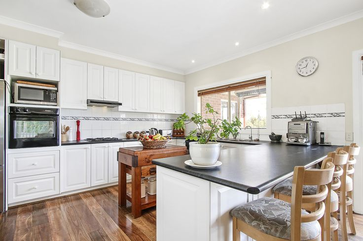 Another view of the spacious and very workable kitchen. Easy to keep clean. Easy to access everything needs and space to prepare and serve in comfort.
