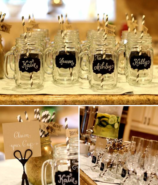 "Chalkboard name tags on mason jars awaited the baby shower guests next to a ""Claim your Cup"" sign - cute!"