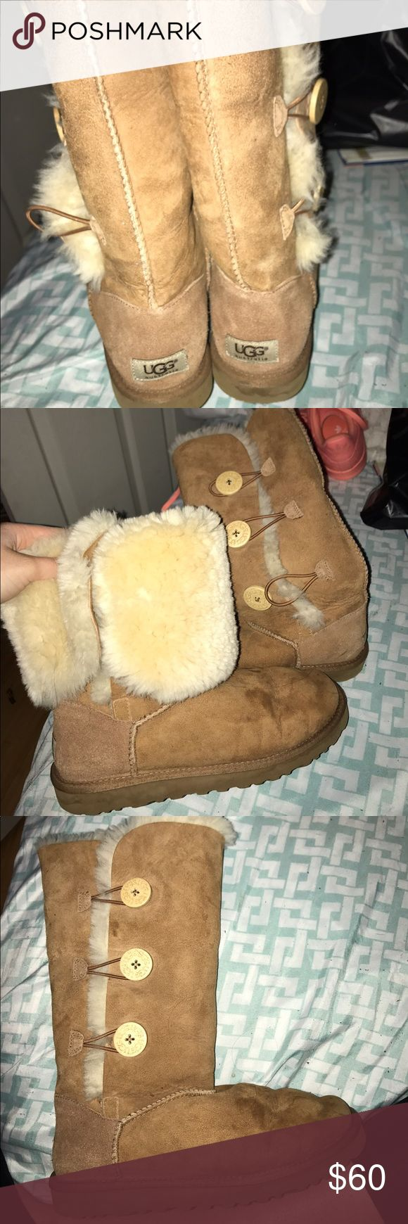 tall Ugg chestnut 3 buttoned boot Chestnut tall Ugg boots with 3 button detail on side. Fur intact. Worn a couple of times- some damage to the exterior. sold as is UGG Shoes Winter & Rain Boots