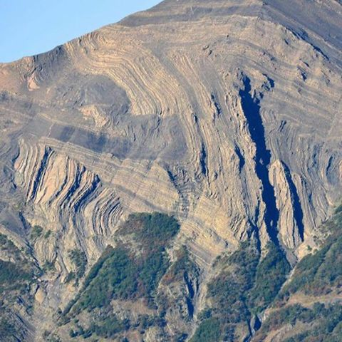 Large-scale folding and faulting exposed in a mountainside, Argentinian Patagonia.