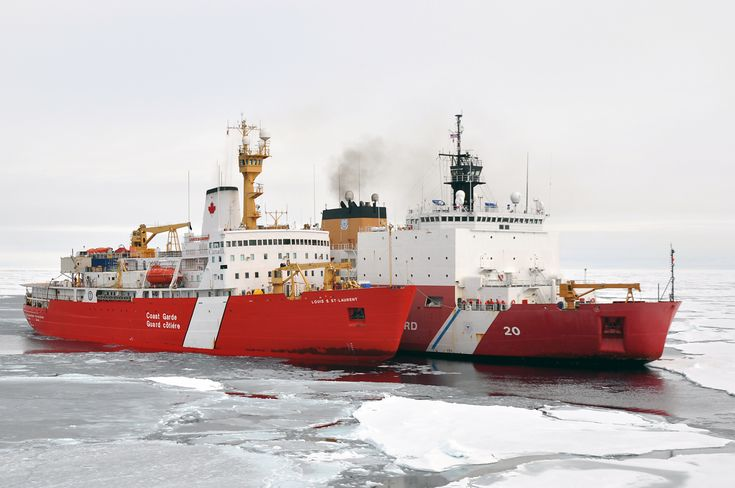 "Ice-breakers CCGS Louis S. St-Laurent and USCGC Healy on a joint-exercise in the Arctic. Original caption:  ""In this photo released by the U.S. Coast Guard, the Canadian Coast Guard Ship Louis S. St-Laurent ties up to the Coast Guard Cutter Healy in the Arctic Ocean, Sept. 5. The two ships are taking part in a multi-year, multi-agency Arctic survey that will help define the North American continental shelf."""