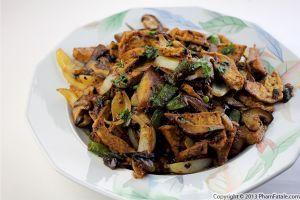 mushroom tofu stir fry.The stir fry is composed of combined shiitake mushrooms, oyster mushrooms and enoki mushrooms, Japanese eggplant, sugar snap peas and ...