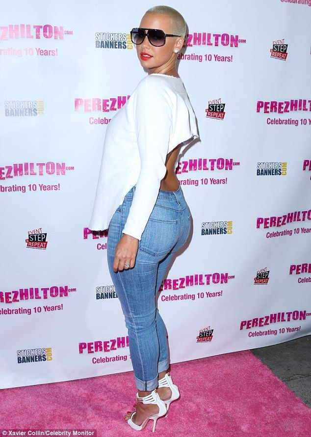 Curvy frame: Amber Rose showed off her voluptuous figure in a tight pair of faded denim jeans on Saturday in Hollywood, California