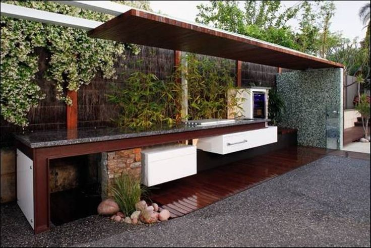 Modern and natural concrete outdoor kitchen with bamboo for Modern outdoor kitchen designs