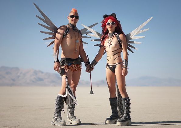 """burning man people Scott and the Sauce, a couple calling themselves """"Flying Molecules,"""" created outfits with wings made from scrap metal."""