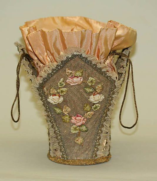 """Listed as a Sewing tool, this bag is made of silk, gilt thread,  cotton. Dated between 1914 -1920. It's 9"""" high.  It's beautifully embroidered and trimmed."""