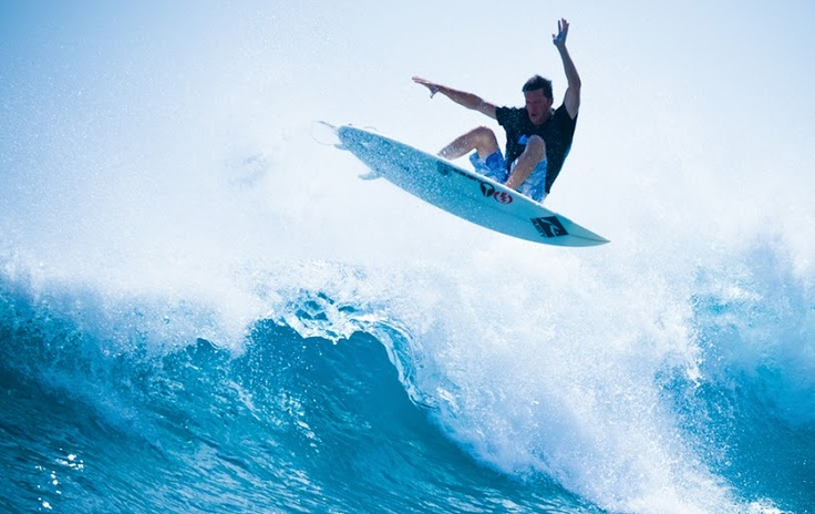 Mike Falkow surfing