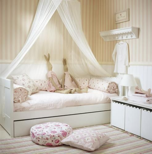 Bunnies on the bed. I love this soooo much. I adore simple and elegant children's rooms. I want my daughter's room to look like this. :)