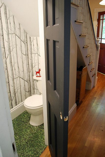 Bathroom under the stairs -- this outdoors theme is the kind of hilarious surprise I enjoy, lol