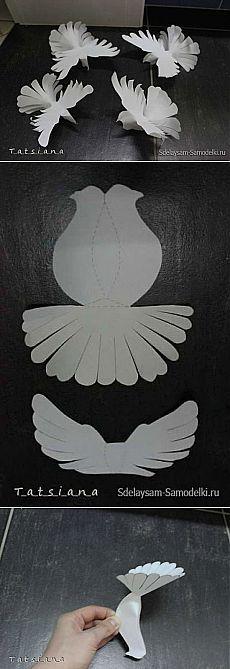 Pombas brancas de papel
