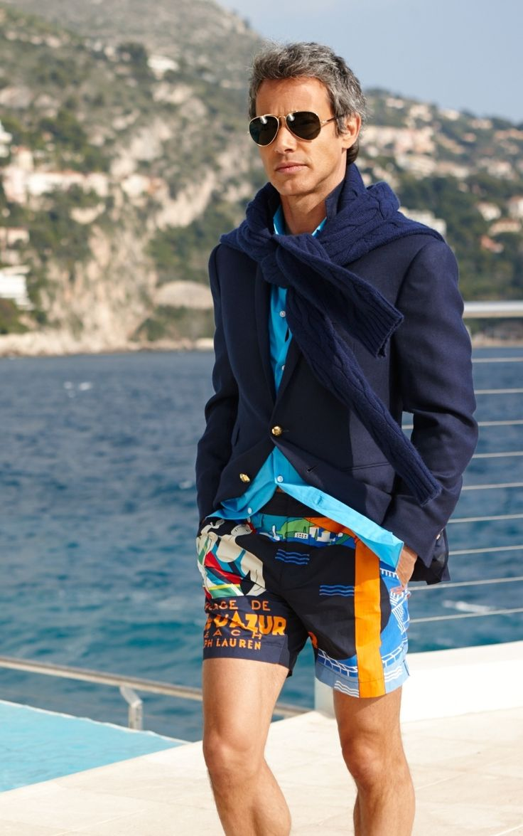 Crafted in Italy, this trim-fitting Ralph Lauren Purple Label swim trunk features vibrant, Riviera-inspired imagery and buckled waist tabs for a personalized fit.