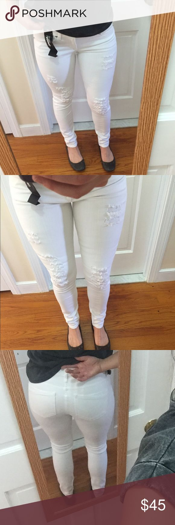 NWT Distressed White Skinnies A brand new, perfectly distressed pair of white skinny jeans from Express! Super stretchy and soft with rips in all the right places - the rips are done pretty tightly so there are big gaping holes or places where your skin will smoosh out :) $88 price, tags still attached. Happy to answer any questions! Generous size 4 - i'm a 6 and these are doable, just pretty snug! Express Jeans Skinny