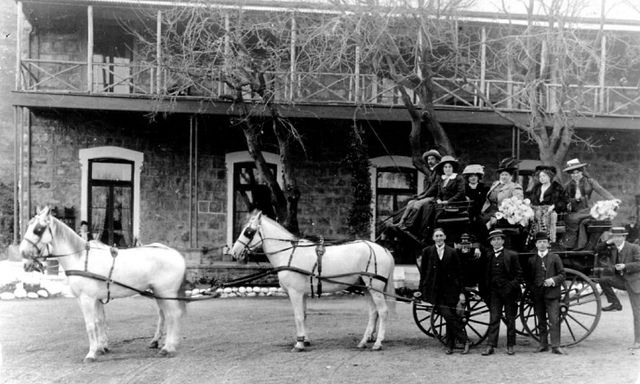 Travellers outside the Royal Hotel, Hout Bay, c1910