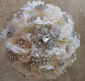 Softer approach to the brooch bouquet... may open my eyes to fake flowers