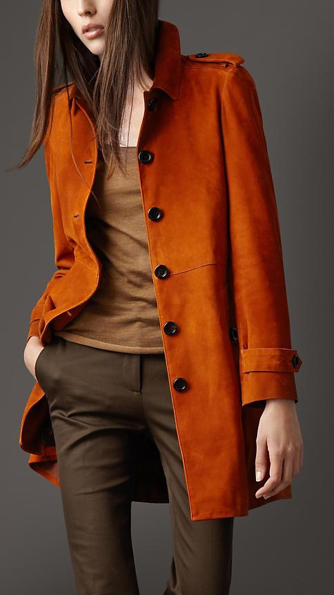 """An orange suede trench always does the trick and is perfect for fall. Pair with other neutral earth tones for the full effect."""