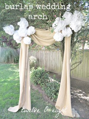 Burlap wedding arch...for The Broadway, you could do this arch with different flowers, of course, and then put drapes behind...maybe shears in the wedding colors or event the wood piece that Mike can make.