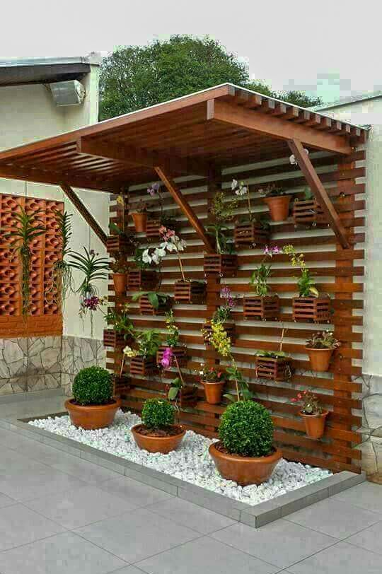 Home Green Wall Plants Hanging on Wooden Panels on Terrace