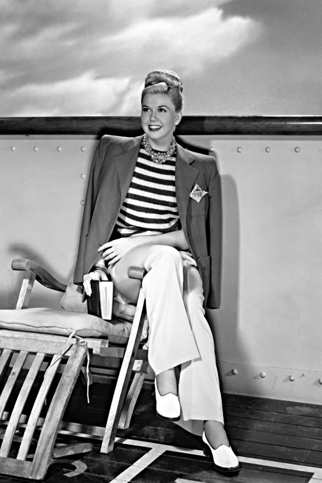 1948. Doris Day working the classic nautical trend during the filming of 'Romance On The High Seas' in 1948. Draping the blazer with the squared shoulder pads is exceptionally classy. . . Marie Claire, UK