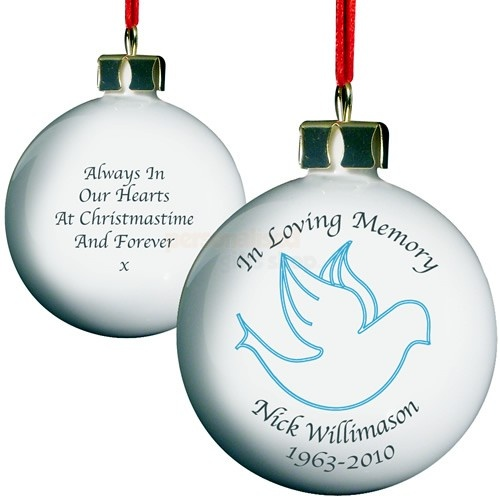LAST ORDER DATE FOR CHRISTMAS DELIVERY 15TH DECEMBER 12 NOONThis lovely bone china Personalised In Loving Memory Christmas Bauble - For Him is a touching way to remember your loved one. Decorated with a blue Dove, it can be personalised on the front with HIS first and last name as well as years.On the back of the bauble you can have any dedication of your choice, of 80 characters which will be displayed over 4 line.Hanging this quality Personalised In Loving Memory Christmas Bauble , on the…