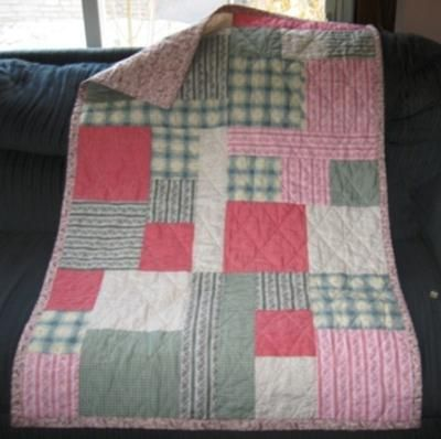 Pink Pastel Quilt: This is a quilt I made with a collection of fabric that came together with a pattern. It was very quick and easy to complete and makes a great pattern