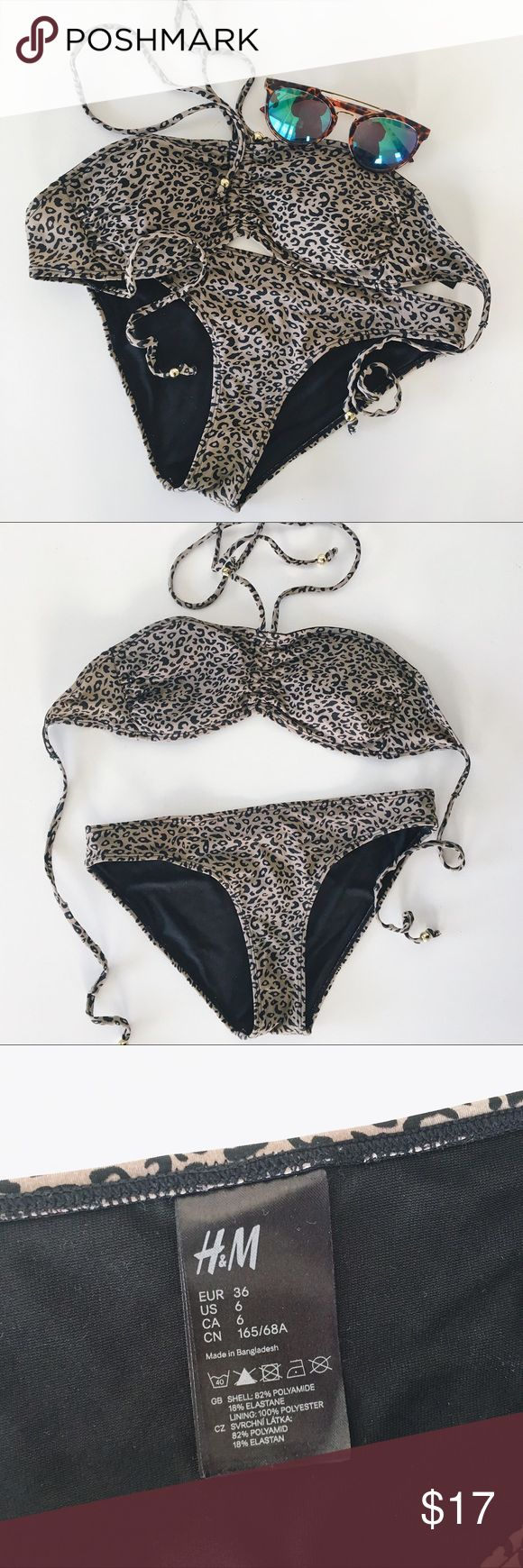 H&M Grey Leopard Print Bikini Cute little grey cheetah print bikini from H&M. Ruched bandeau top with ties at the neck and ties at the back. Small gold bead at the ends of each tie. Removable padding on the top. Classic bikini style bottoms. Only worn twice - great condition except for a small split seam which is unnoticeable and could easily be sewn back together - see picture for detail. Size 6 from H&M -  fits like a size small. H&M Swim Bikinis