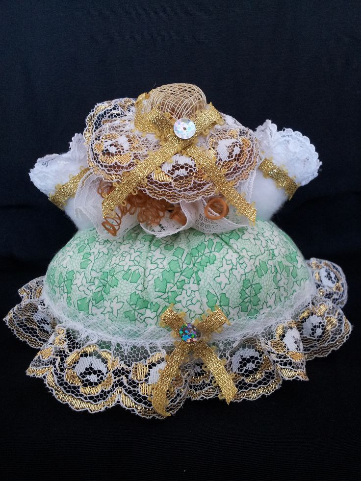 The Irish Belle. Back view. Collectable Pin Cushion Doll. Material: Cotton & Lace. $25.00CAD + S/H if applicable. $0.00 Tax. Please contact Nola here at: www.facebook.com/elegantcreationsbynola  for purchase
