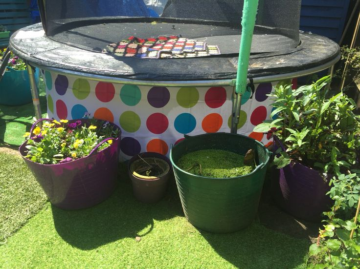 Hated the view under the trampoline of dead grass, was going to make a fabric skirt (one day ), but laying wide awake at 3am this morning in popped the idea of hanging a shower curtain around it! Hey pesto, it looks great! And now I can hide my hose, balls etc underneath! And the extra fabric I cut makes a fab matching table cover!