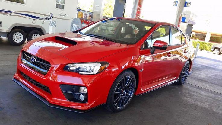 2015 Subaru WRX Limited (Lightning Red) with full STI underbody kit, STI turn signal mirrors and oem JDM wide angle heated glass, 18x8.5 (2010) STI Spec-C wheels, 245/40WR18