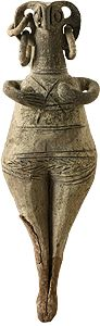 Clay female figurine with a bird-shaped face and disproportionately large ears, from which hang two rows of hoop earrings. Figurines of this type copy earlier Syrian models and are predominant in the Late Cypriot II period (1450-1200 BC).