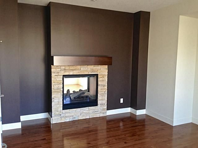 Double sided fireplaces! Smart and stylish. Warm up in the den or in the great room.