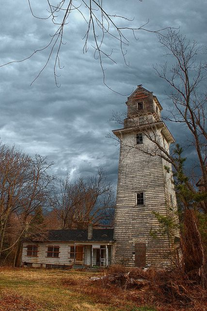 Beautiful abandoned farm water tower, Ocean Township, New Jersey. Built to look like a New England lighthouse.  Awesome picture.