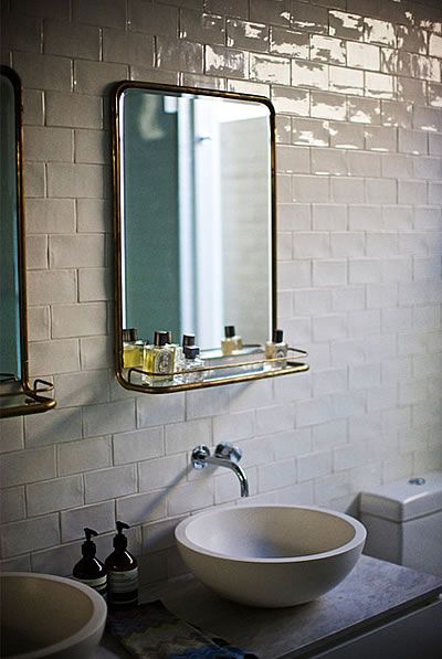 Handsome Mix of the Old; White Subway Tiles, and Vintage Mirrors with Shelf, and the New; Honed Stone Bowl Sinks, and Modern Toilet.