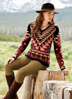 Southwestern blanket geometrics are striking on this collectible art knit v-neck. Masterfully intarsia knit of smooth and bouclé pima yarns in gorgeous shades of wine, dusty pink, sage, amber, beeswax and black. Refined with handcrocheted trim at the v-neck, cuffs and picot-scalloped hem.