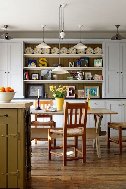 Country style farmhouse dining roomin London kitchen with dresser shelves - explore our dining room design ideas on HOUSE - design, food and travel by House & Garden.