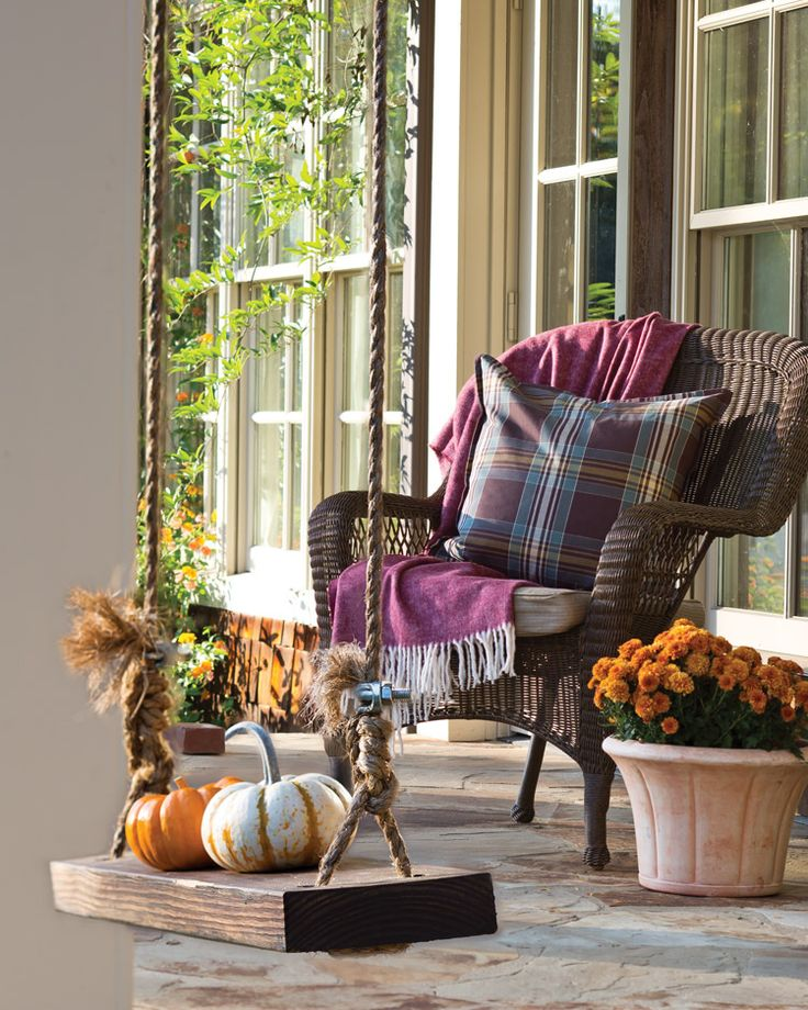Pumpkins on Parade! A chair made cozy with a woolen blanket and a plaid cushion provides an enticing spot to indulge in a leisurely afternoon of reading. - victoriamag.com