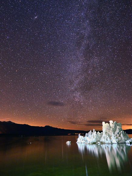 """Stargazing at Mono Lake, California  Photograph by Shreeni Vasanm    A tufa rock formation juts out of Mono Lake, brilliant under a starry sky. Mono Lake sunrises and sunsets are famous because of the colors reflected in the tranquil water, Travel Favorites submitter shreenivasanm says. """"If one has the will to venture to the lake shore during the night, you could experience a visual spectacle of … billions of stars."""""""