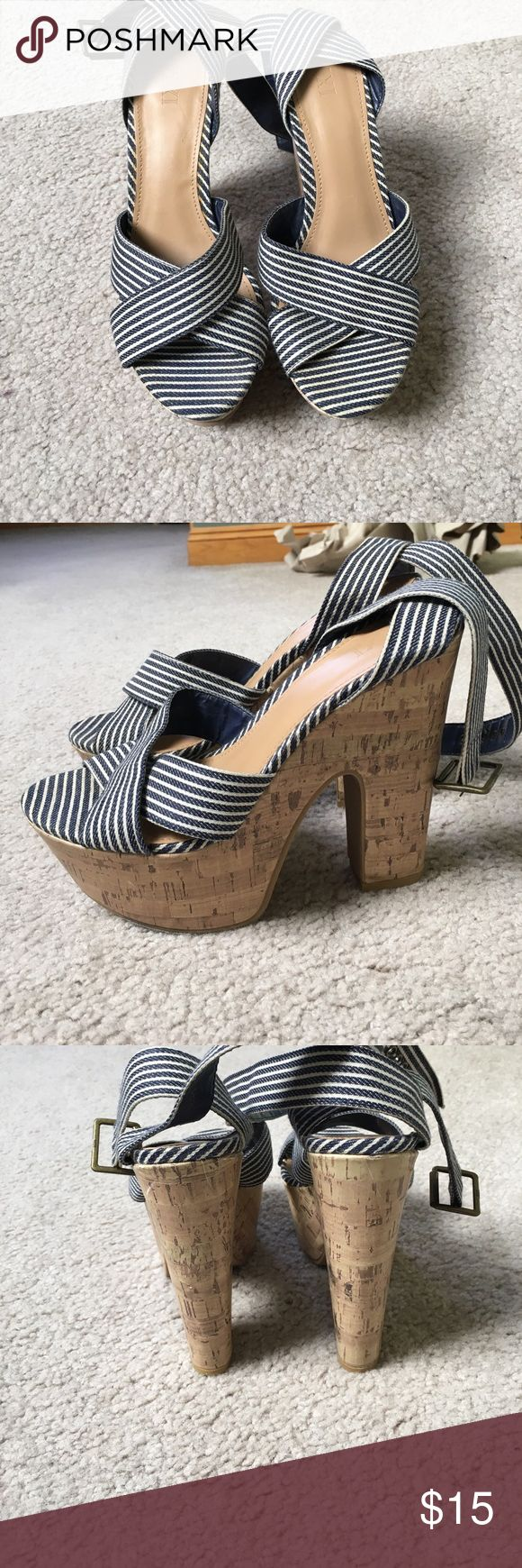 Nautical Strappy Heels These shoes absolutely rock! With their high cork chunky platform heel. The blue and white striped pattern with the strappy buckles make for a perfect summer shoe! Forever 21 Shoes Heels