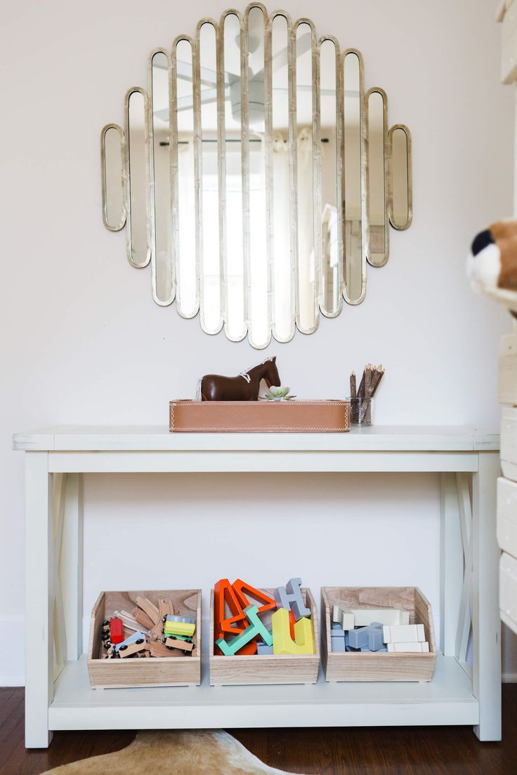 kids playroom ideas - wooden storage crates from Target and a statement mirror.