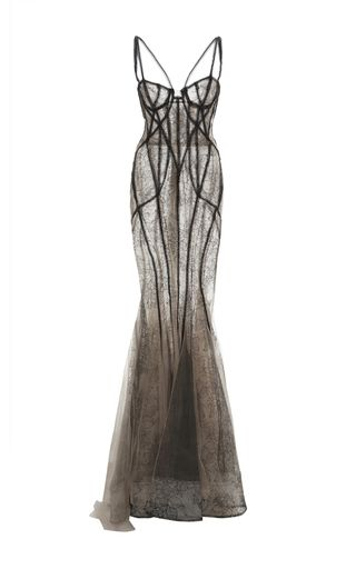 This chantilly lace **Marchesa** gown features a bugle beaded corset and a fishtail skirt with tulle inserts at the hem.