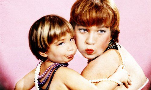 Shirley Maclaine and her daughter Sachi Parker as they make faces during a photo shoot, January 1959. Photo Allan Grant